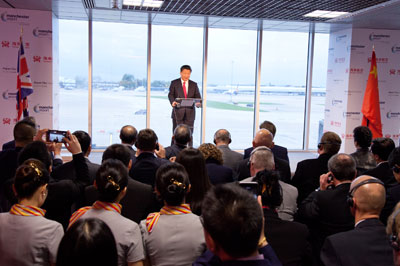 President Xi Jinping at Manchester Airport making an announcing that Hainan Airlines will be opening their Beijing to/from Manchester route the following year.
